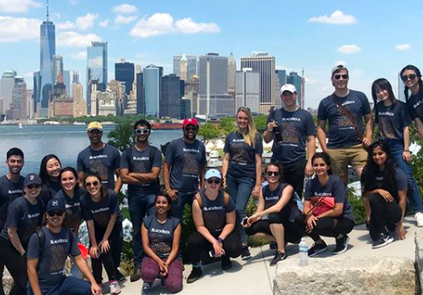 BlackRock summer interns volunteering at a clean-up in a park on Governors Island in NY.