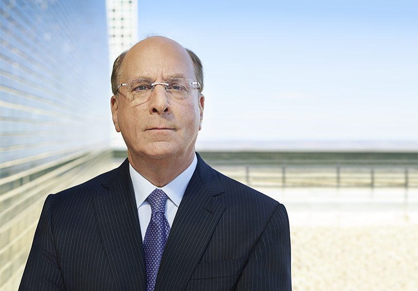A close up shot of Larry Fink, BlackRock CEO, looking directly at the camera